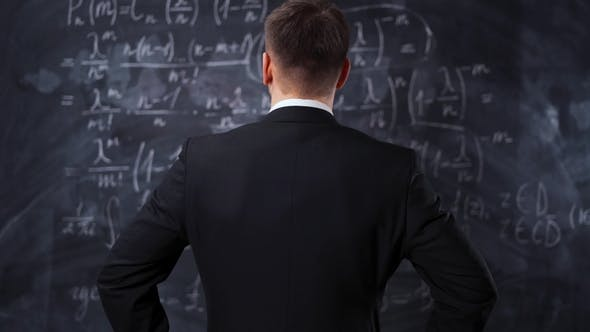Thumbnail for Rear View of Man Against Chalkboard with Math Formula Equations