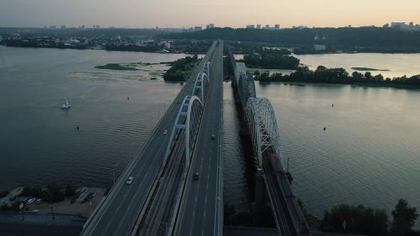 Aerial Footage. Radial Fly Above Kyiv Bridge at Sunset