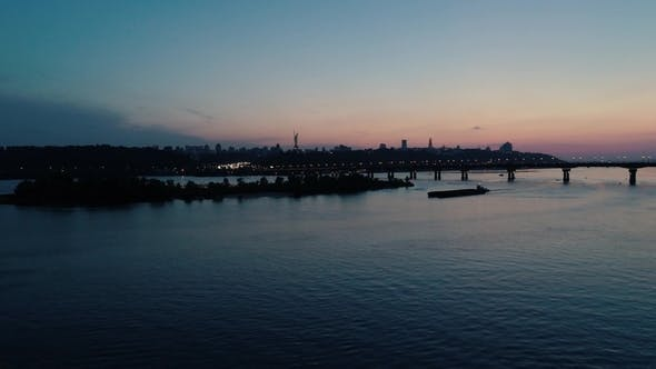 Aerial Footage. Fly Rise Above Kyiv Dnipro River at Evening