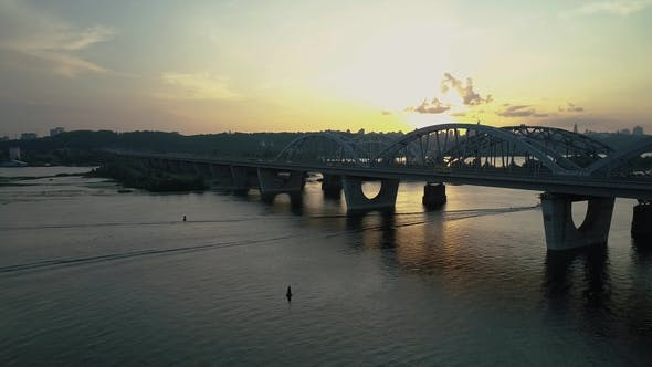 Thumbnail for Aerial Footage. Fly Rise Above Kyiv Bridge at Sunset