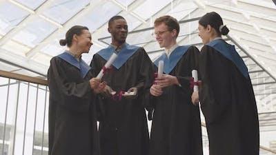 Portrait of Four Graduates