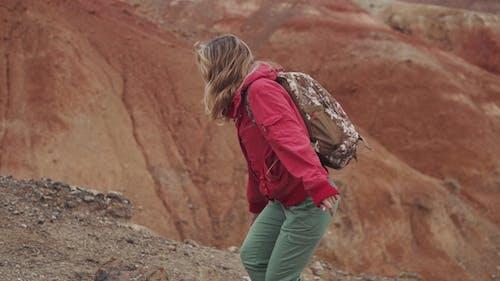 Traveler Ascends a Steep Hill