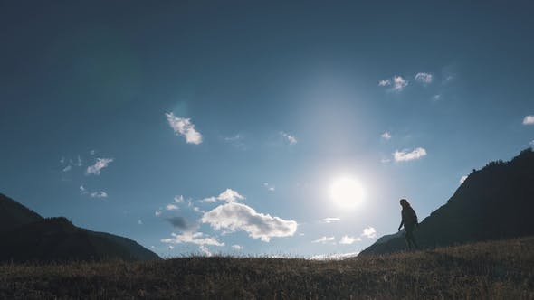Thumbnail for Silhouette of a Traveler in the Background of Mountains and Sky