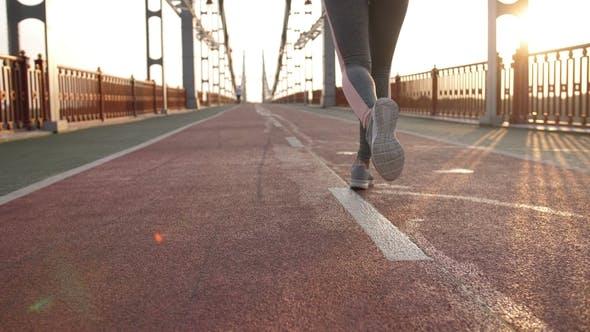 Thumbnail for Back View Legs of Runner Female on Bridge