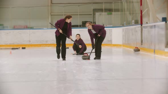 Thumbnail for Curling - Leading Granite Stone on the Ice - Rubbing the Ice Before the Stone