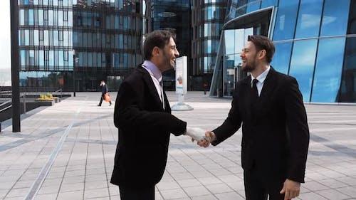 Businessman Shaking Fake Hand of Partner