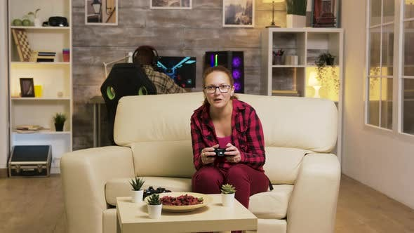Thumbnail for Young Woman Excited After Her Victory While Playing Video Games