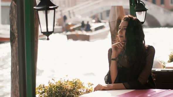 Thumbnail for Travel Tourist Woman in Cafe Against Beautiful View on Venetian Chanal in Venice, Italy.