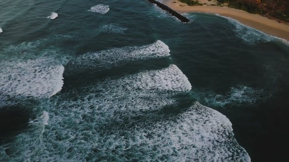 Thumbnail for Drone Flying Right Over Epic Foaming Waves Breaking, Reaching Ocean Shore
