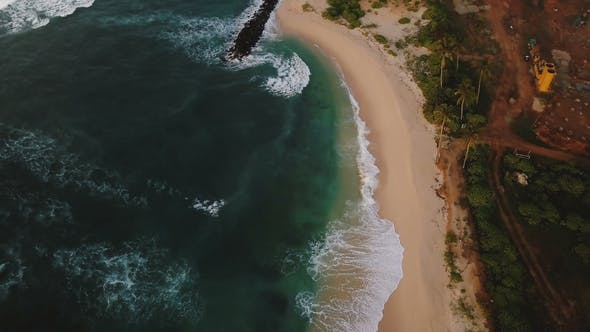 Thumbnail for Aerial Birds Eye View of Beautiful Foaming Sea Waves Reaching Shore, Stone Breakwater and Coastline