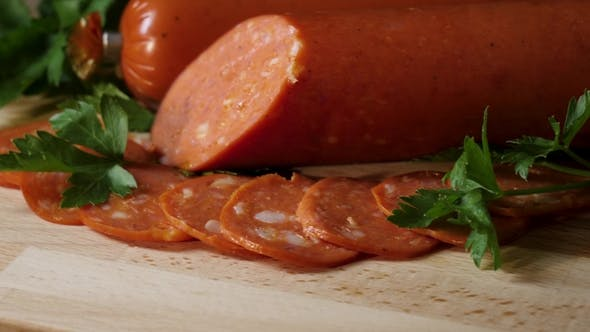 Thumbnail for Sliced Pepperoni Sausages on Wooden Cutting Board. Frame. Detail of Sliced Pepperoni Sausages
