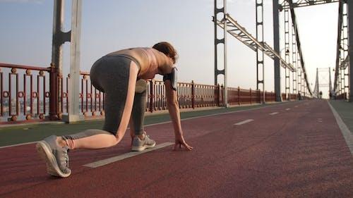 Female Starts Running From Sprinter Position
