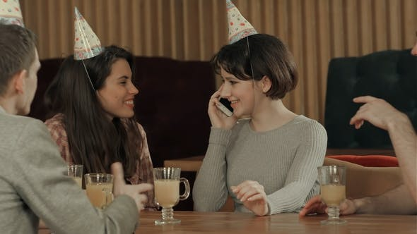 Thumbnail for Young Girl Celebrating Birthday in Cafe, Talking on Cell Phone