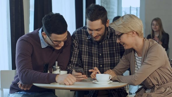 Thumbnail for Group of Young Creative People Wearing Business Casual Clothes Collaborating at Meeting Table