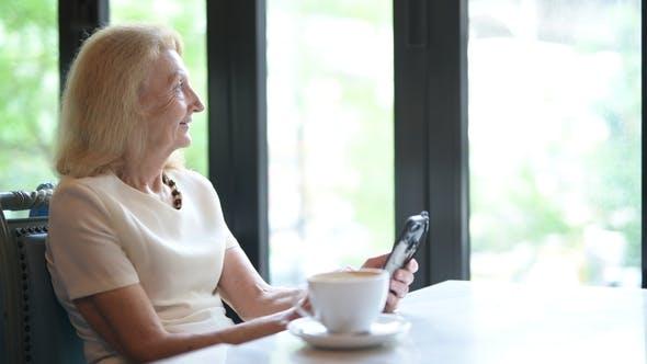 Thumbnail for Happy Senior Elderly Woman Using Mobile Phone