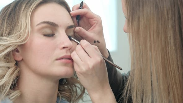 Thumbnail for Make-up Artist Applying Eyelash Makeup To Model Eye