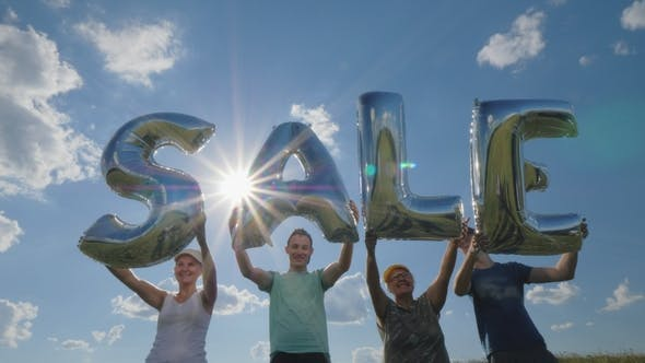 Thumbnail for Several People Hold Balloons with the Word Sale