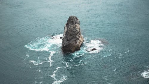 Jagged Rocks Protrude From Sea