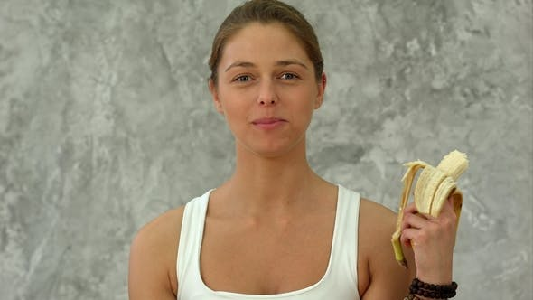 Thumbnail for Young Woman Eating a Banana