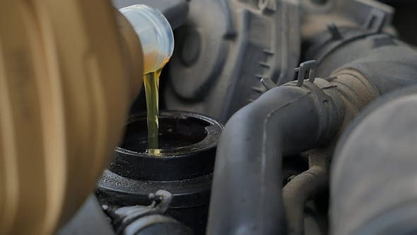 Thumbnail for Pouring Oil To Car Engine