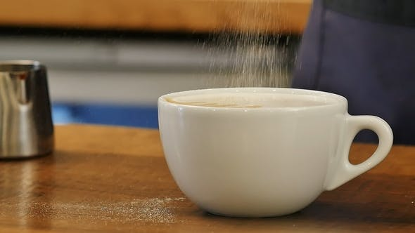 Thumbnail for White and Small Cup of Coffee Served with Latte Art on Wood Plate