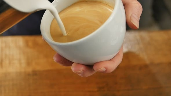 Thumbnail for Pouring Milk Into Coffee