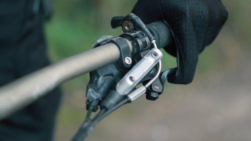 Biker's Hand Holds Steering Wheel