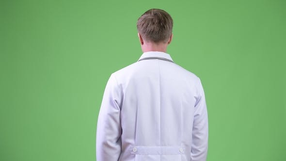 Thumbnail for Back View Of Young Man Doctor Turning