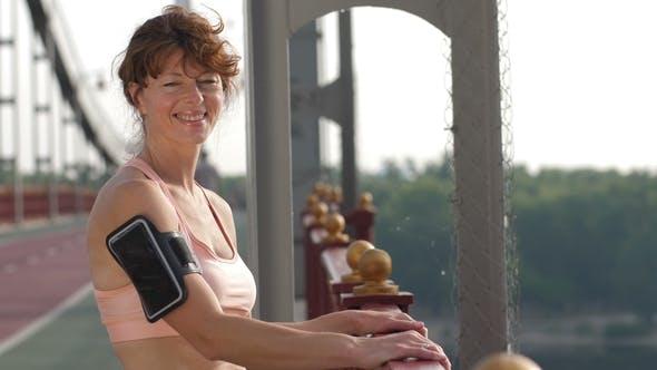 Thumbnail for Smiling Senior Female Runner Posing at Camera