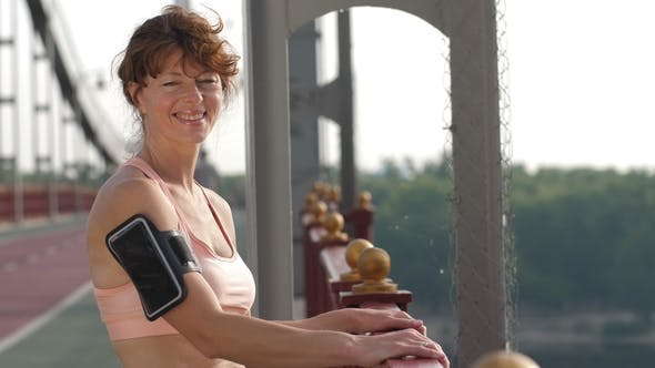 Cover Image for Smiling Senior Female Runner Posing at Camera