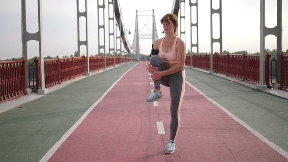 Thumbnail for Senior Redhead Womans Stretching Leg Muscles