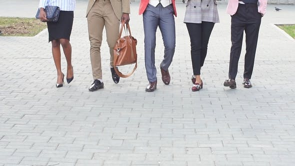 Cover Image for Attractive Stylish Business People Is Going To the Conference