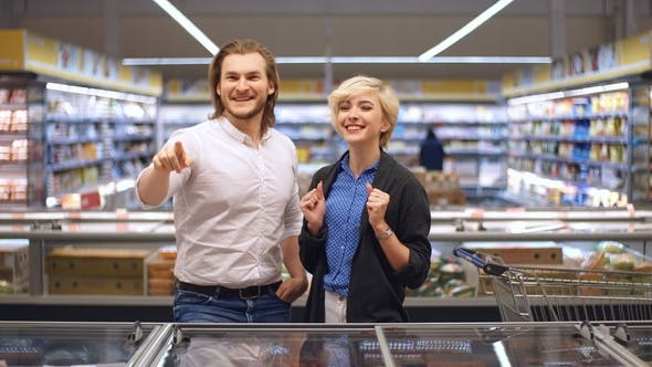 Thumbnail for Happy Caucasian Couple Choosing Frozen Food at Grocery Store in Shopping Mall