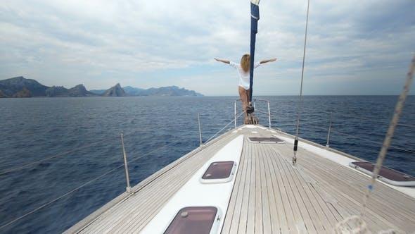 Thumbnail for Beautiful Woman on Sailboat Following Legs Feet on Luxury Summer Lifestyle Happy Adventure Travel