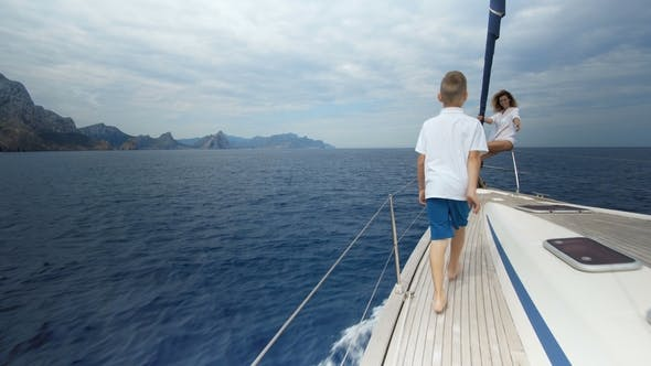 Thumbnail for Freedom of the Ocean for Healthy Family on Outdoor Summer Vacation Sailing on Luxury Yacht. Mother