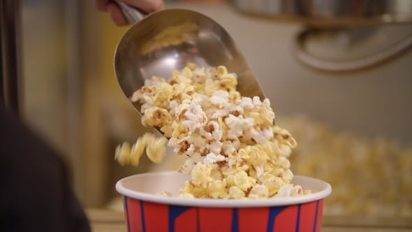 Thumbnail for Popcorn Pouring in Container with Ladle