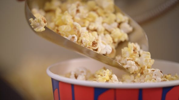 Thumbnail for Popcorn Flakes Pouring By Ladle To Paper Container in