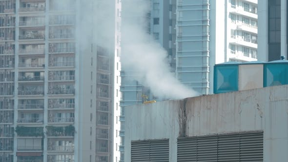 Thumbnail for View of Steam on the Roof in the City