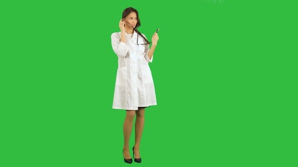 Thumbnail for Funny Female Nurse Playing with a Stethoscope on a Green Screen, Chroma Key
