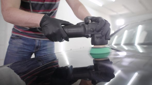 Thumbnail for Professional Polishing Black Car Hood with Special Polishing Machine on a Car Service