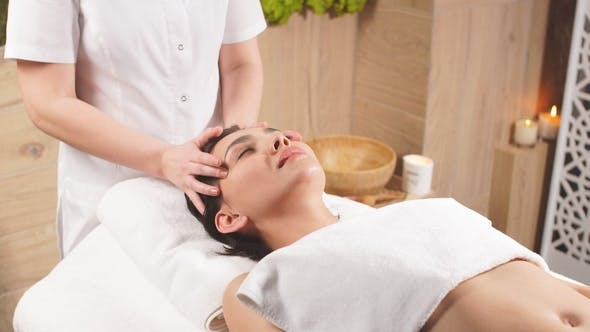 Thumbnail for Young Beautiful Woman with Black Hair Getting Massage Therapy