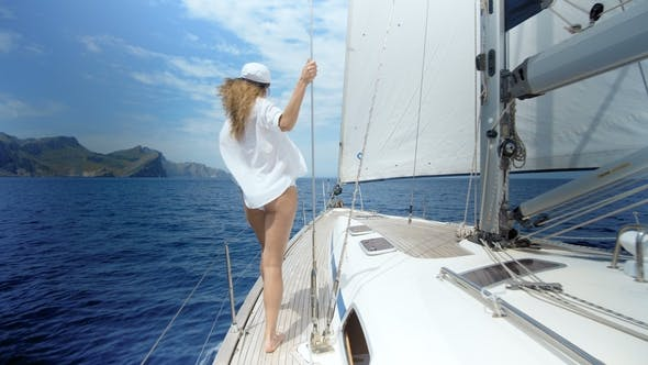 Thumbnail for Beautiful Woman on Sailboat on Luxury Summer Lifestyle Happy Adventure Travel Vacation
