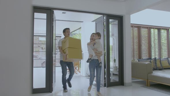Cover Image for Happy Family with Kids Holding Boxes Entering New Modern House