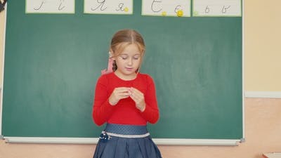 Girl Standing Near the Blackboard