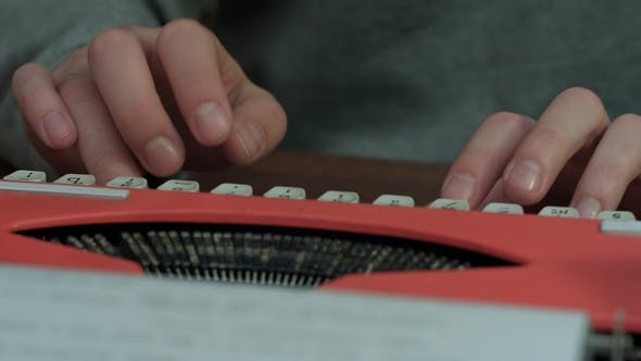 Thumbnail for Male's Hands Typing on a Red Typing Machine