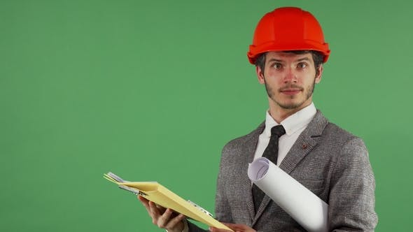 Thumbnail for Bearded Male Engineer Looking Confused While Reading Documents