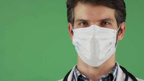 Thumbnail for Male Doctor Wearing Medical Mask Smiling Joyfully