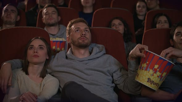 Thumbnail for Loving Couple Embracing in Cinema. Cinema Friends Enjoy Film