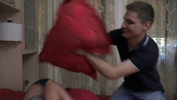 Thumbnail for Beautiful Girl and Handsome Guy Beating Pillows