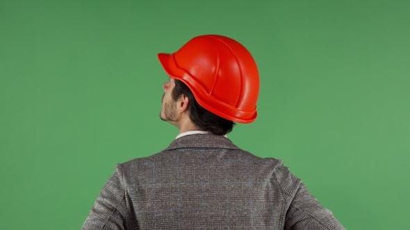 Thumbnail for Rear View Portrait of a Contractor Wearing Hardhat Looking at the Green Screen